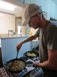 Jay cooking breakfast