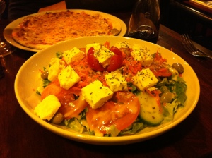 The had delicious salad & pizza, and good table wine