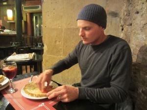Spreading fresh tomato and garlic on the bread
