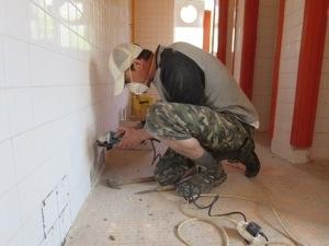 grinding out broken tiles