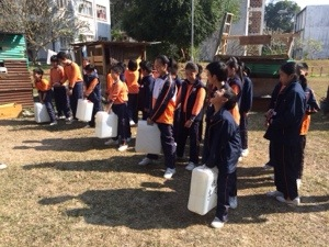 the kids feel the heaviness of typical amount of water that must be carried