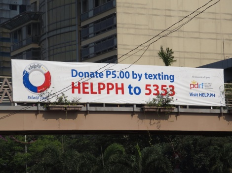 sign over roxas blvd for typhoon relief donations (note P5.00 is approx 10 cents)