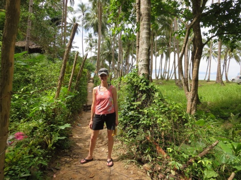 from the road, it's a short walk down a dirt path to reach the beach