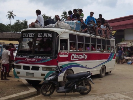 at the bus station...it was typical to see buses overloaded beyond capacity