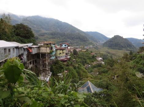 homes hug the edge of the mountainside