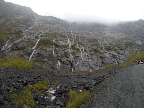 cliffs streaming with waterfalls lined both sides of the road