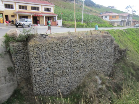 a gabion retaining wall, we just put one of this in at our house, now I see them everywhere